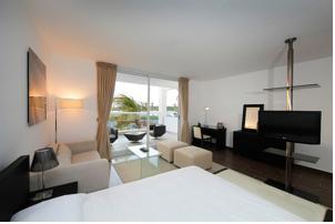 Town center suites playa blanca en playa blanca panama for Habitacion familiar riu playa blanca