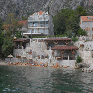 Hotel Amfora, situated on the edge of the Bay of Kotor, offers suites with ...