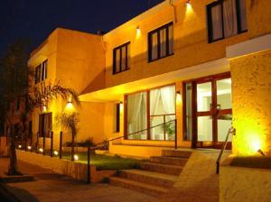 Hotel palmas del lago en villa carlos paz argentina for Hotel villa del lago